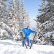 Happy man with ski in the winter landscape — Stock Photo