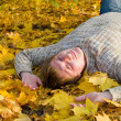 Man rest on the autumn leaf — Stock Photo