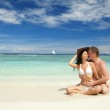 Young couple on the beach of sea — Stock Photo #9255876