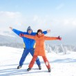 Happy couple with ski in the winter landscape — Stock Photo #9255882