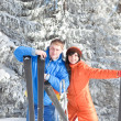 Happy couple with ski in the winter landscape — Stock Photo