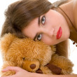 Young beautiful woman with toy bear — Stock fotografie