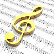 Treble clef on sheet of printed music - Stock Photo