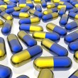 Blue and yellow pills on white background — Stock Photo