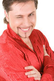 Young man winks at camera — Stock Photo