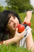 Pretty woman eating green apple — Stock Photo