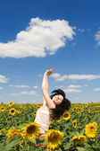 Woman in the field of sunflowers — Stock Photo
