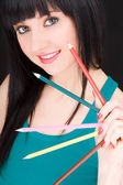Young woman with varicolored pencils — Stock Photo