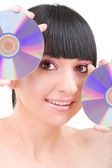 Young beautiful girl with disks — Stock Photo