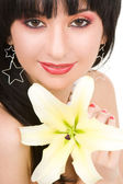 Young woman with lily flower — Stock Photo