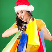 Fun santa woman with color packages — Stock Photo