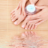 Care for beautiful woman legs, hands and nails — Stock Photo