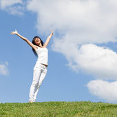 Happy young woman dreams to fly on winds — Stock Photo