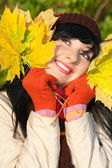 Young pretty woman in the autumn park — Stock Photo