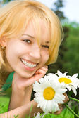 Fun woman rest in the park with flowers — Stock Photo
