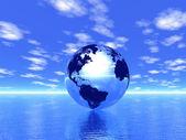 Globe in ocean — Stock Photo