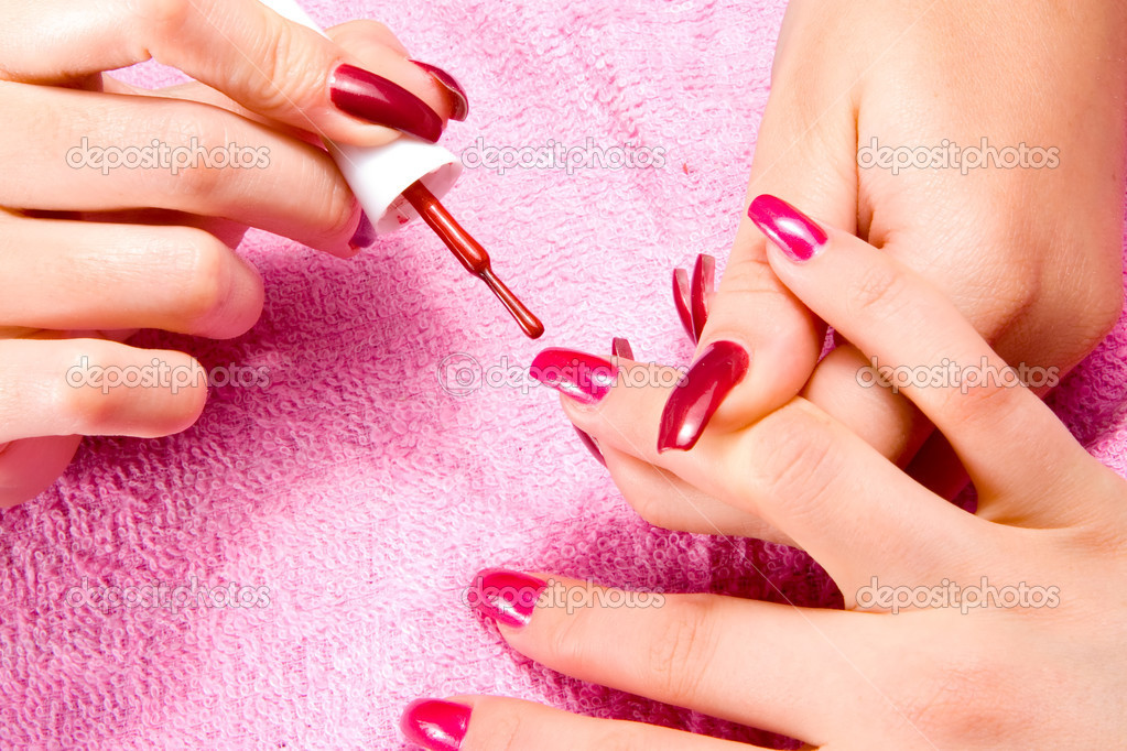 Young woman with beautiful long nails make the manicure — Stock Photo #9253508
