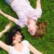Pretty women rest on the green grass — Stock Photo