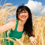 Happy woman in golden wheat — Stock Photo