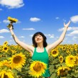 Happy woman in the field of sunflowers — Stock Photo #9426517