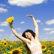 Fun woman in the field of sunflowers — Stock Photo #9426519