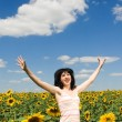 Fun woman in the field of sunflowers — Stock Photo #9426520