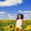 Fun woman in the field of sunflowers — Stock Photo #9426521