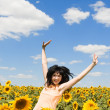 Fun woman in the field of sunflowers — Stock Photo #9426523