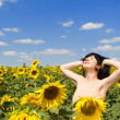 Happy woman in the field of sunflowers — Stock Photo #9426524