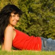 Sweet woman rest on the grass — Stock Photo