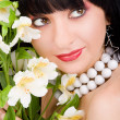 Pretty woman portrait with flowers — Stock Photo #9426660