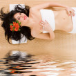 Cute woman relaxing in spa — Stockfoto