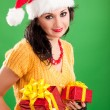 Fun santa woman with christmas gift — Stock Photo