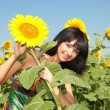 Young woman in the field of sunflowers — Stock Photo #9427567
