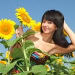 Fun woman in the field of sunflowers — Stock Photo #9427573