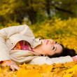 Young pretty woman on the autumn leaf — Stock Photo