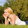 Stock Photo: Sweet woman rest on the green summer grass