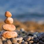 Balanced stones on the sea — Stock Photo #9429312