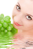 Pretty woman with green grape — Stock Photo