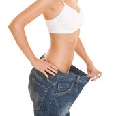 Funny woman shows her weight loss — Stock Photo