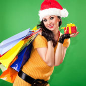 Fun santa woman with gift box and color packages — Stock Photo