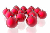 Red christmas decoration on the white background — Stock Photo