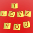 "Yellow paper pinned to a red background with inscription ""I love — Stock Photo"