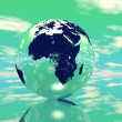 Globe in green background — Stock Photo