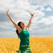 Happy woman jumping in golden wheat — Stock Photo #9756876