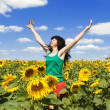 Fun woman in the field of sunflowers - Foto Stock