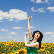 Fun woman in the field of sunflowers - Stockfoto