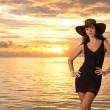 Royalty-Free Stock Photo: Fashion woman on the sea sunset background