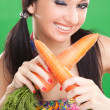 Expression girl with carrot on the green background — Stock Photo