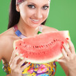 Fashion woman with watermelon on the green background — Stock Photo #9757579